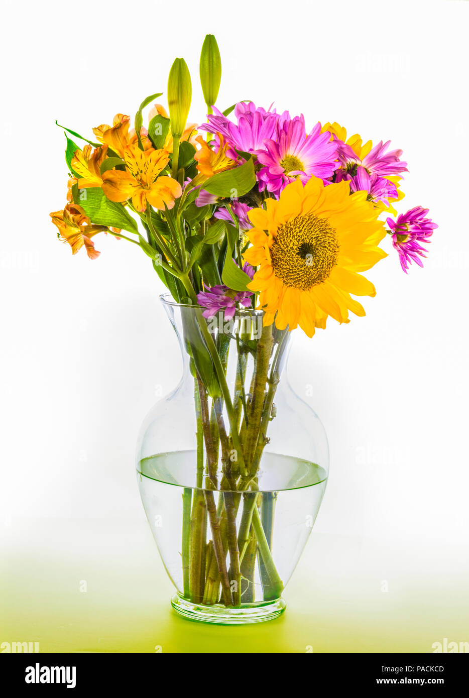 Attractive  bouquet arrangement of multi colored flowers in clear glass vase Stock Photo