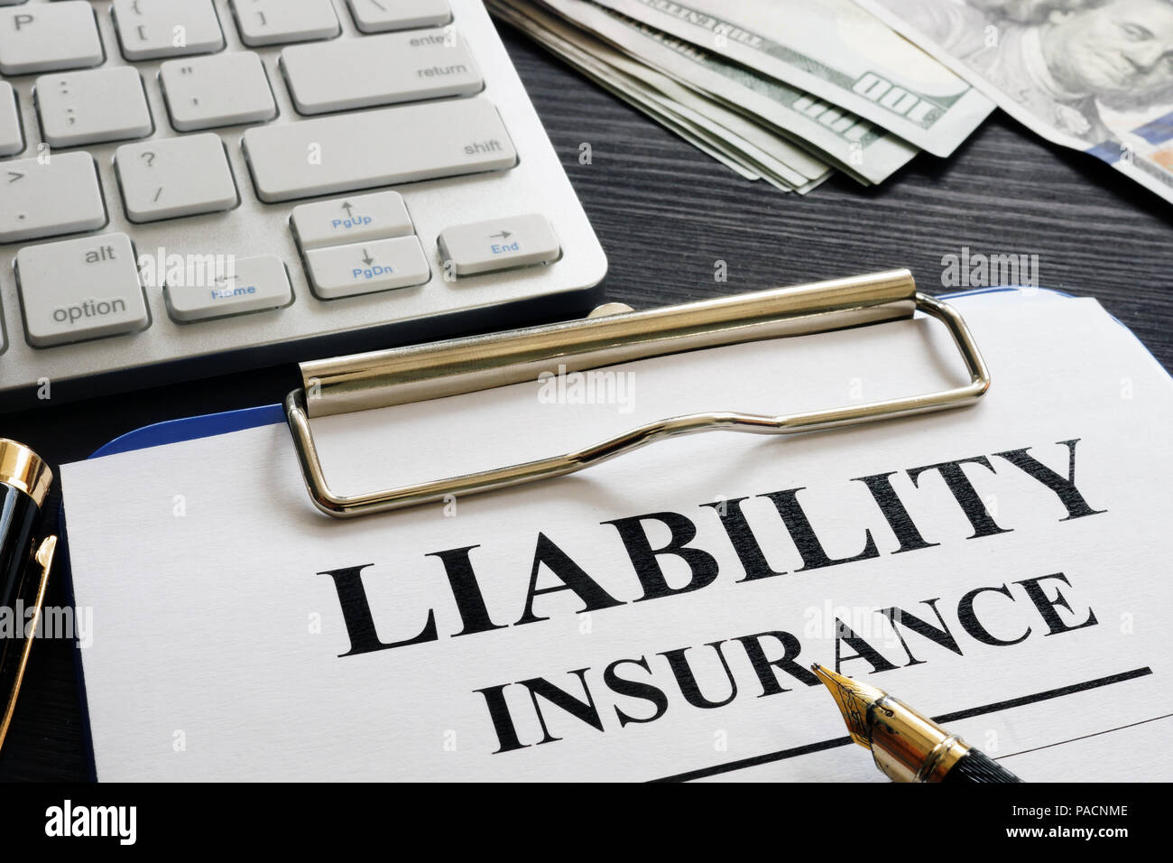 Liability insurance agreement on the desk. - Stock Image