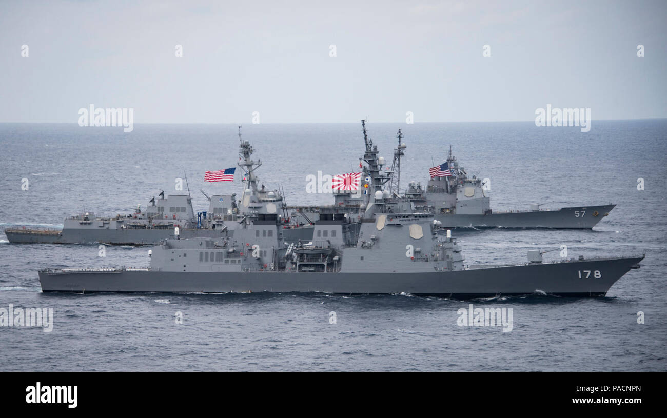PHILIPPINE SEA (April 28, 2017) The Japan Maritime Self-Defense Force destroyer JS Ashigara (DDG 178), foreground, the Arleigh Burke-class guided-missile destroyer USS Wayne E. Meyer (DDG 108) and the Ticonderoga-class guided-missile cruiser USS Lake Champlain (CG 57) transit the Philippine Sea. The U.S. Navy has patrolled the Indo-Asia-Pacific routinely for more than 70 years promoting regional peace and security. Stock Photo