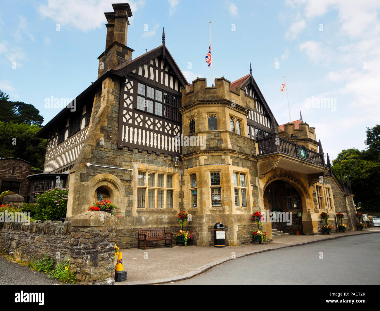 Arts and Crafts building mixing half timbered and stonework construction of Lynton town hall, Devon, UK - Stock Image