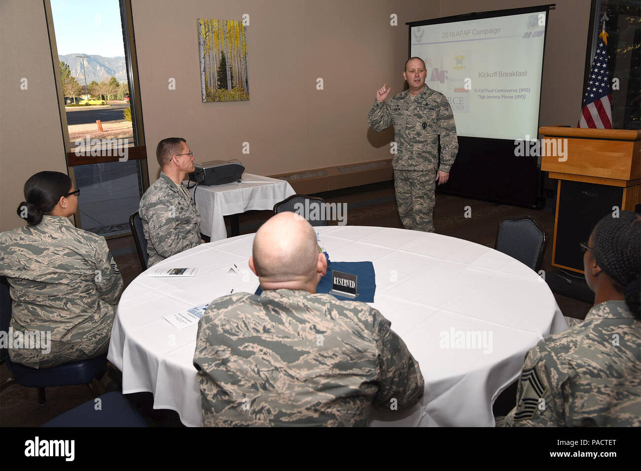 Col. Douglas Schiess, 21st SPace Wing commander, discusses the importance of the Air Force Assistance Fund during the kick off breakfast at the Peterson Club on March 17, 2016. The AFAF mission is to raise funds to support the Air Force family. - Stock Image