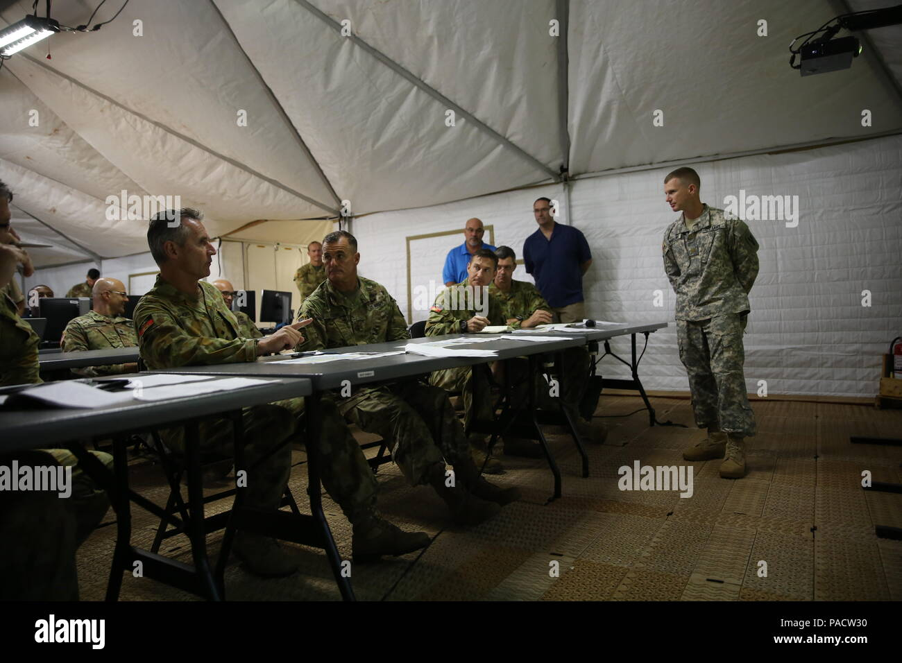 86df80a0 PW Gilmore, Australian Army, commander, Forces Command pauses to talk to  Maj. Gen. Charles A. Flynn, commander, 25th Infantry Division as he  receives a ...