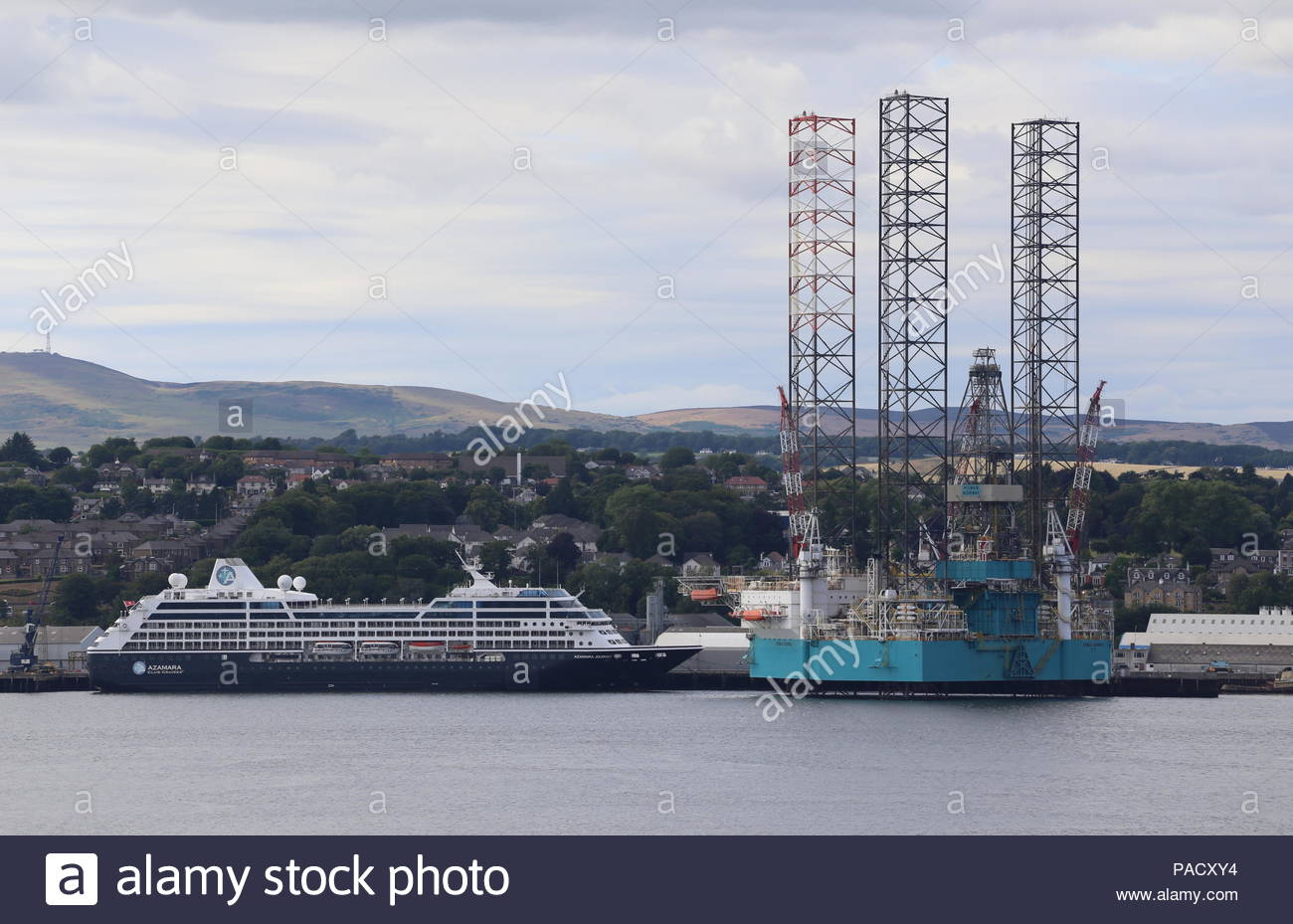 Dundee, UK. 21st July 2018. Cruise ship Azamara Journey and oil rig Rowan Norway at Port of Dundee on warm but overcast day.  © Stephen Finn/Alamy Live News Stock Photo