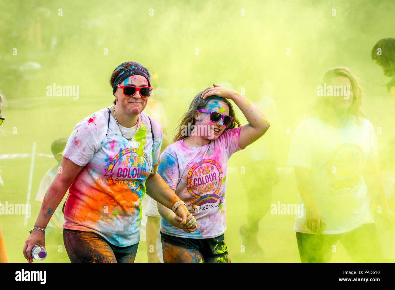 Abington Park, Northampton, U.K. 22nd July 2018. Fun Colour Rush, family event with over 3000 people entered this year raising money for 3 different charities, the organisers had to swap the venue twice because of Travellers on Abington Park up until yesterday lunchtime, after they were removed they went onto the new venue site, so it had to be swapped back again at the last minute. Credit:  Keith J Smith./Alamy Live - Stock Image