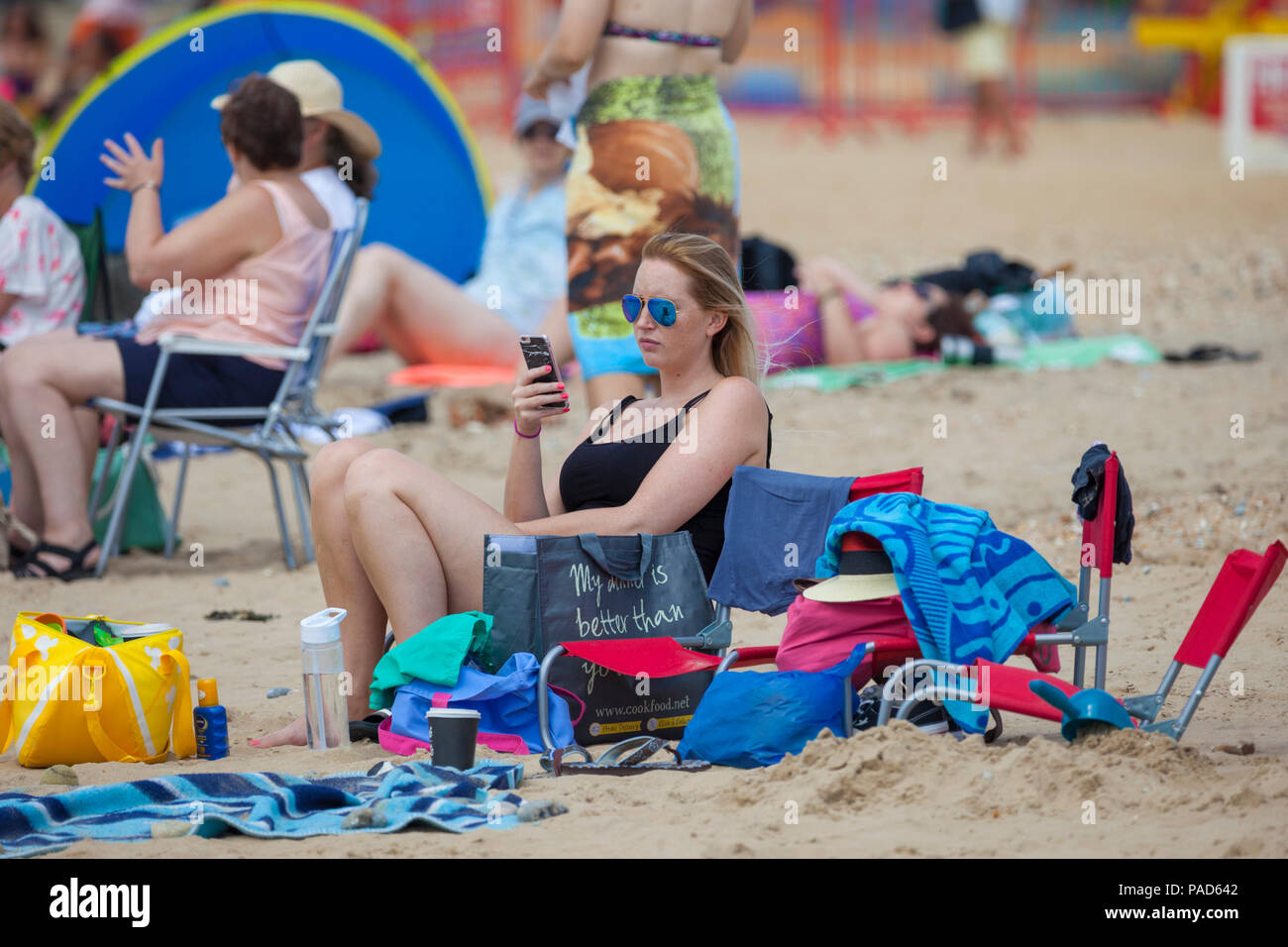 Camber Sands, East Sussex, UK. 22nd Jul, 2018. UK Weather: Hot and sunny weather in camber with scores of people hitting the beach early as this is predicted to be another scorcher of a day. Temperatures are expected to exceed 25°C. Photo Credit: Paul Lawrenson / Alamy Live News - Stock Image