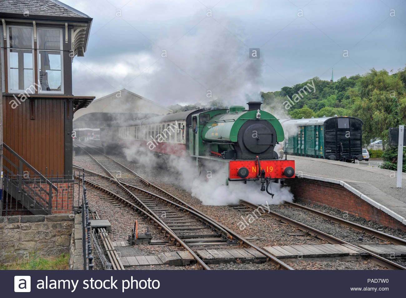 Bo'ness, UK. 22nd July, 2018. First train of the day departs Bo'ness station for Manuel. With local schools closed for the summer holidays rail tours along the River Forth are a popular day out for families. Photo: Roger Gaisford/Alamy Live News - Stock Image