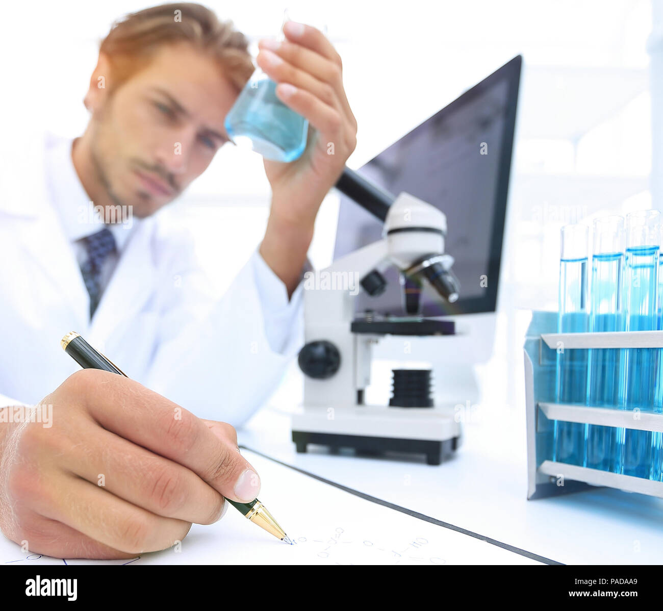 scientist analyzing an experiment in a laboratory - Stock Image