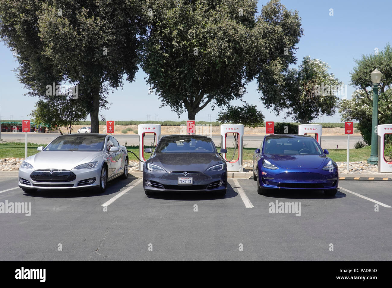 Tesla Supercharging Stations at Harris Ranch, a popular stop over on Interstate 5 in California's Central Valley. - Stock Image