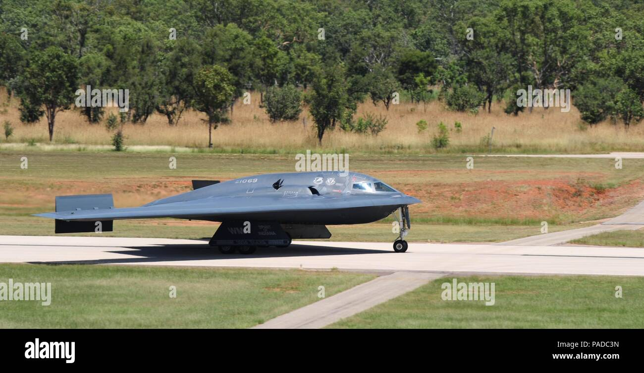 A U.S. Air Force B-2 Spirit bomber deployed from Whiteman Air Force Base, Mo., lands, March 22, 2016, Royal Australian Air Force Base Tindal, Australia. While in the Indo-Asia-Pacific region, the B-2s integrated and conducted training with ally and partner air forces demonstrating the ability to provide an always-ready global strike capability.  (U.S. Air Force photo by Senior Airman Joel Pfiester/Released) - Stock Image