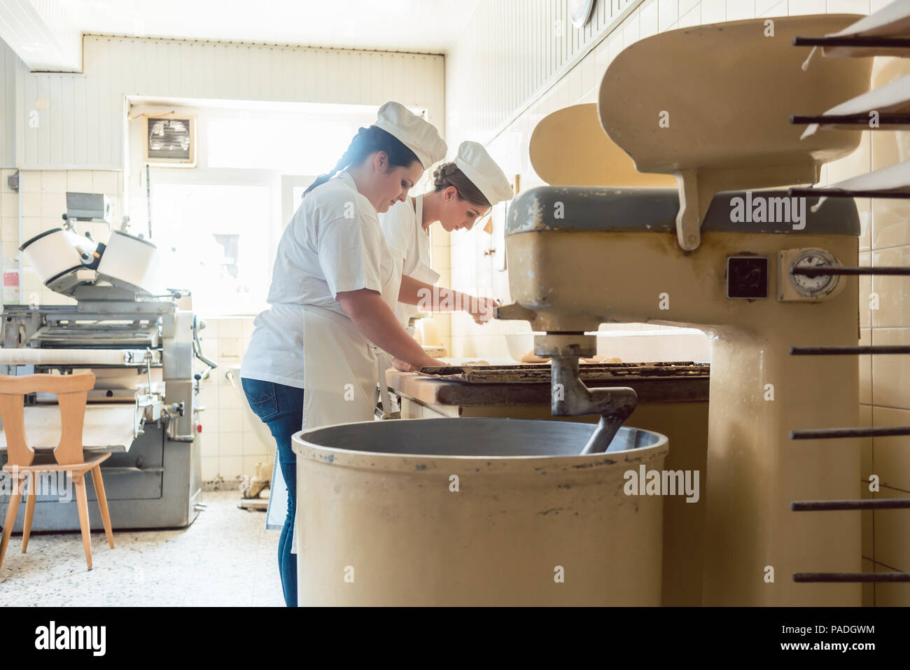 Close-up on baker in bakery forming pretzel bread - Stock Image
