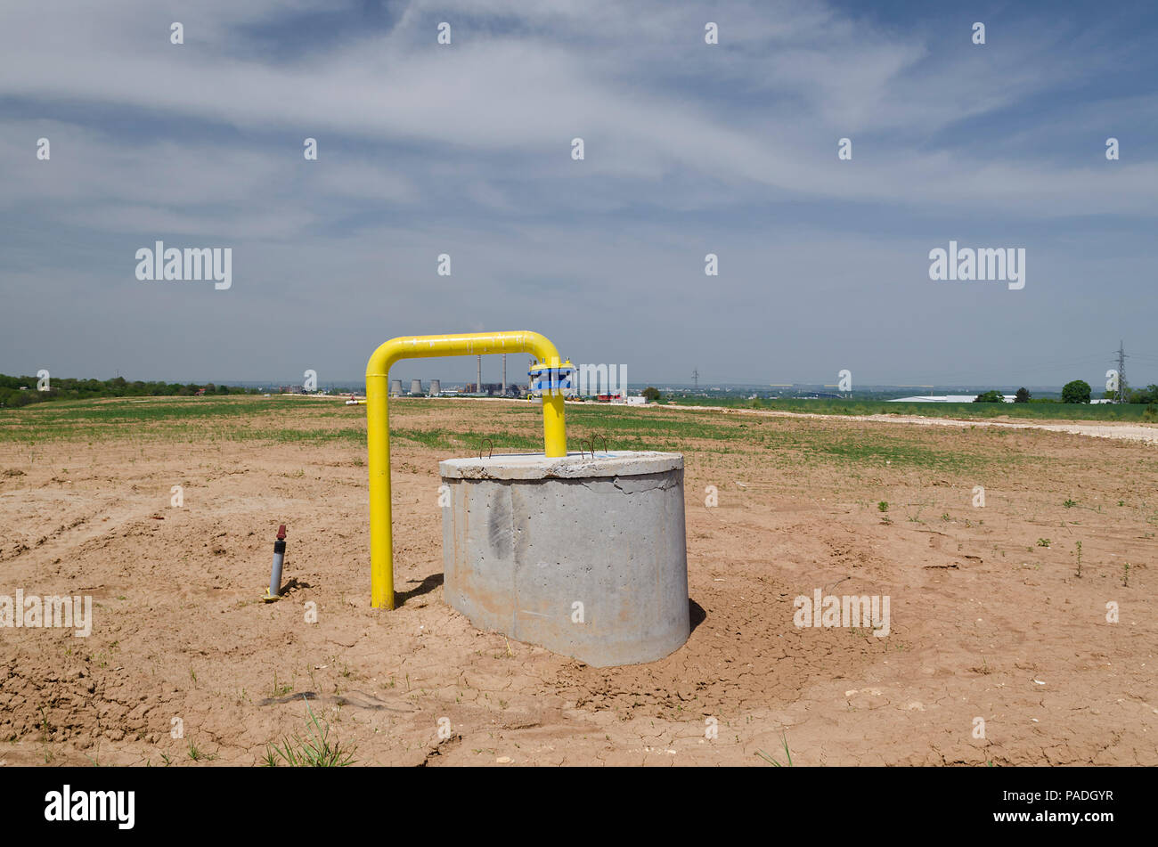 Pollution concept. Reclamation of trash dump or landfill - Stock Image
