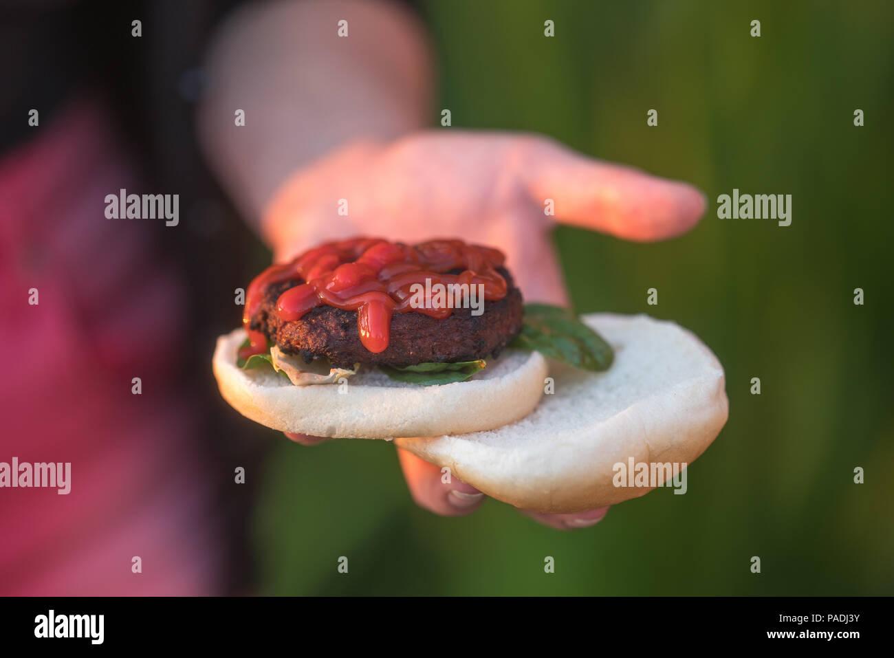 ketchup on hamburger, summer bbq at festival, camping Stock Photo