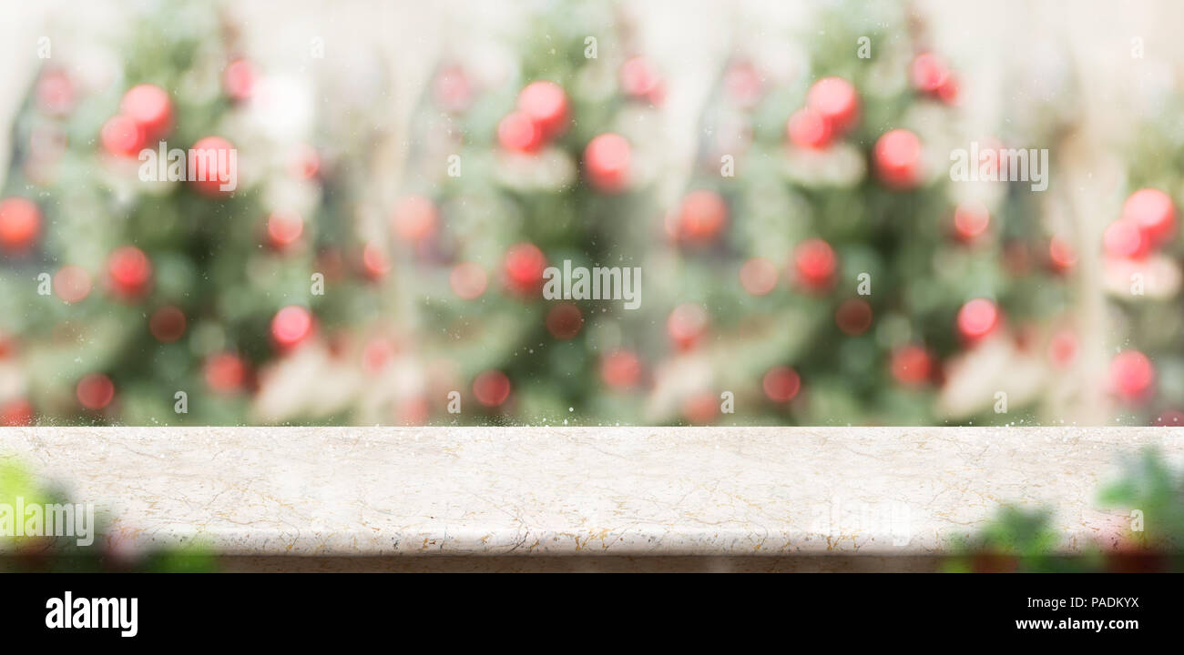 Empty Cream Marble Table Top With Abstract Blur Christmas Tree Red
