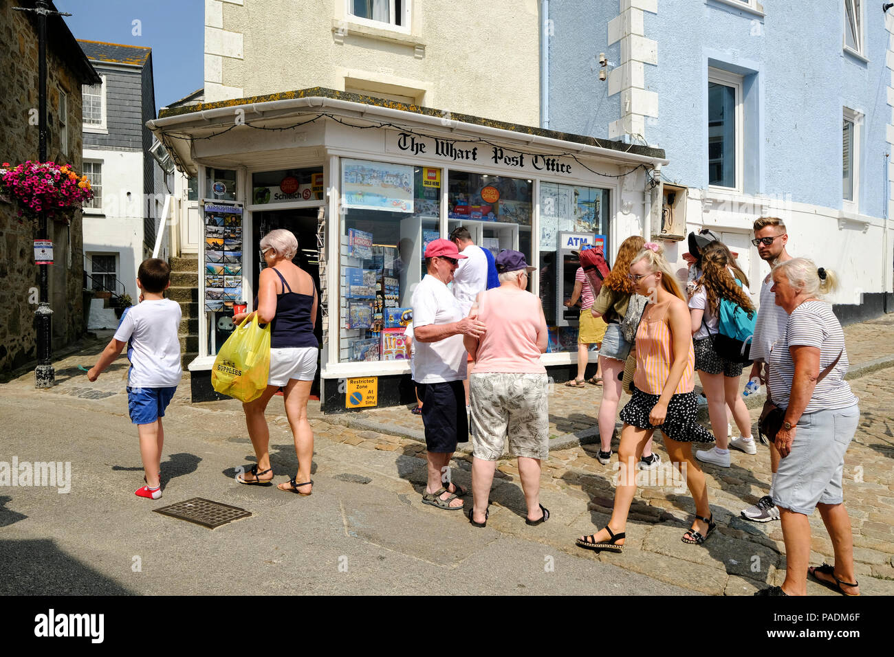 Busy street in St Ives, Cornwall in Summer - Stock Image
