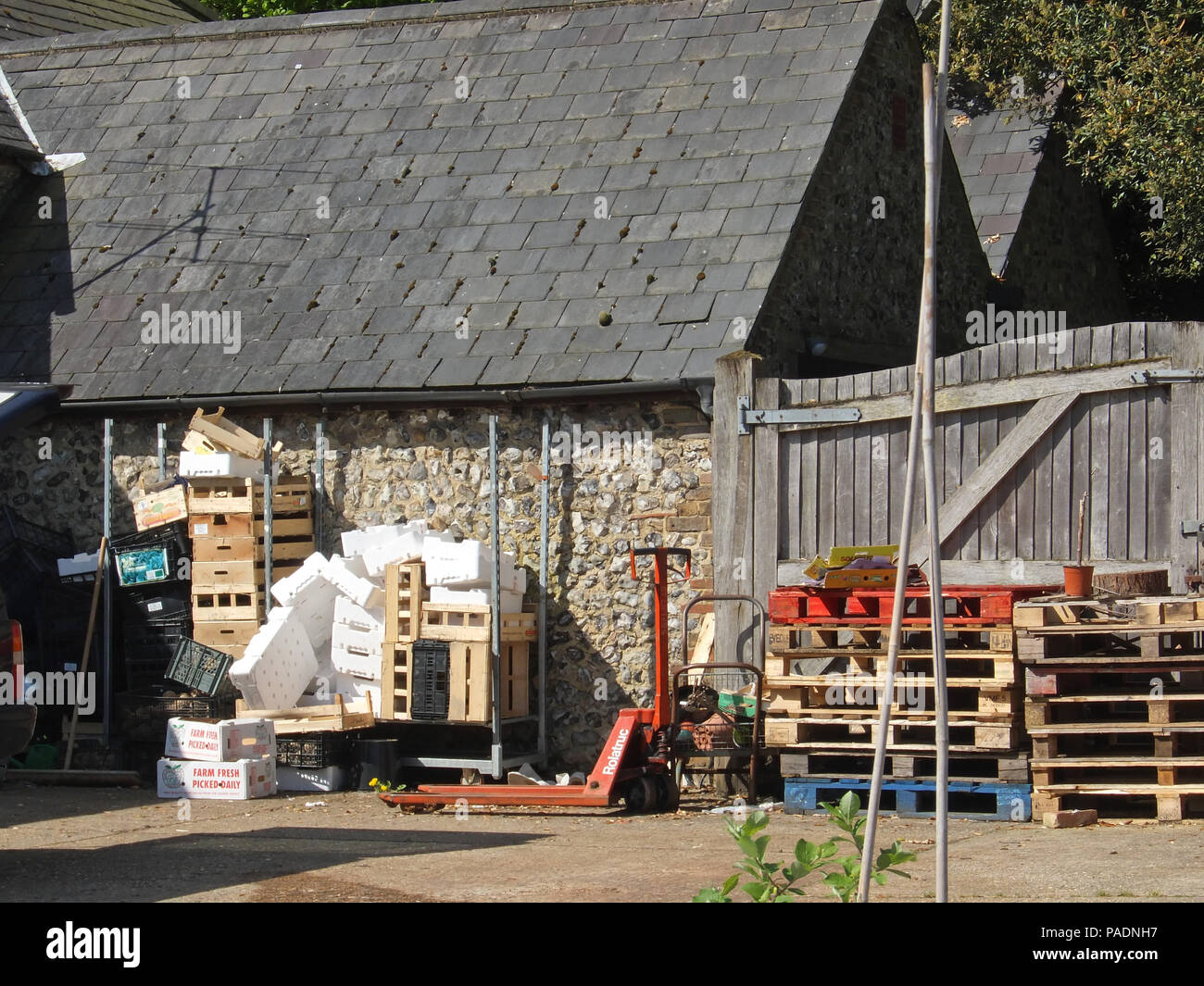 a8414b95f2b Empty wooden fruit and vegetable crates and pallets stacked outside ...