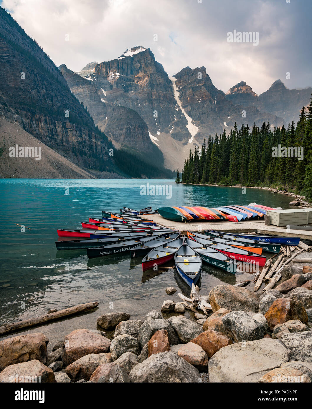 Moraine Lake And Boat Kayak Canoe With Mountains Of Banff