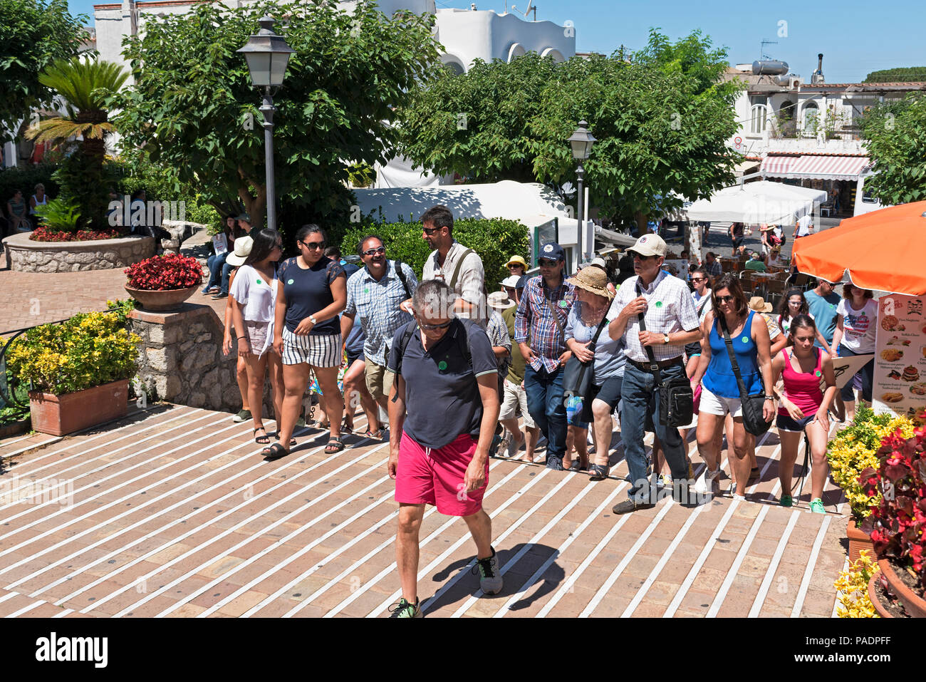 organised tour group, tourists, visitors in anacapri on the island of capri, italy. - Stock Image