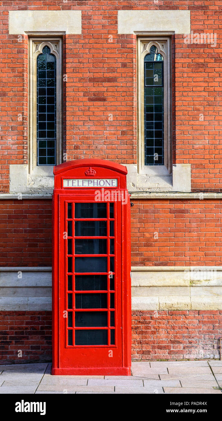 Traditional red Telephone box outside the  Royal Shakespeare Theatre, Stratford upon Avon, Warwickshire, England, Europe - Stock Image
