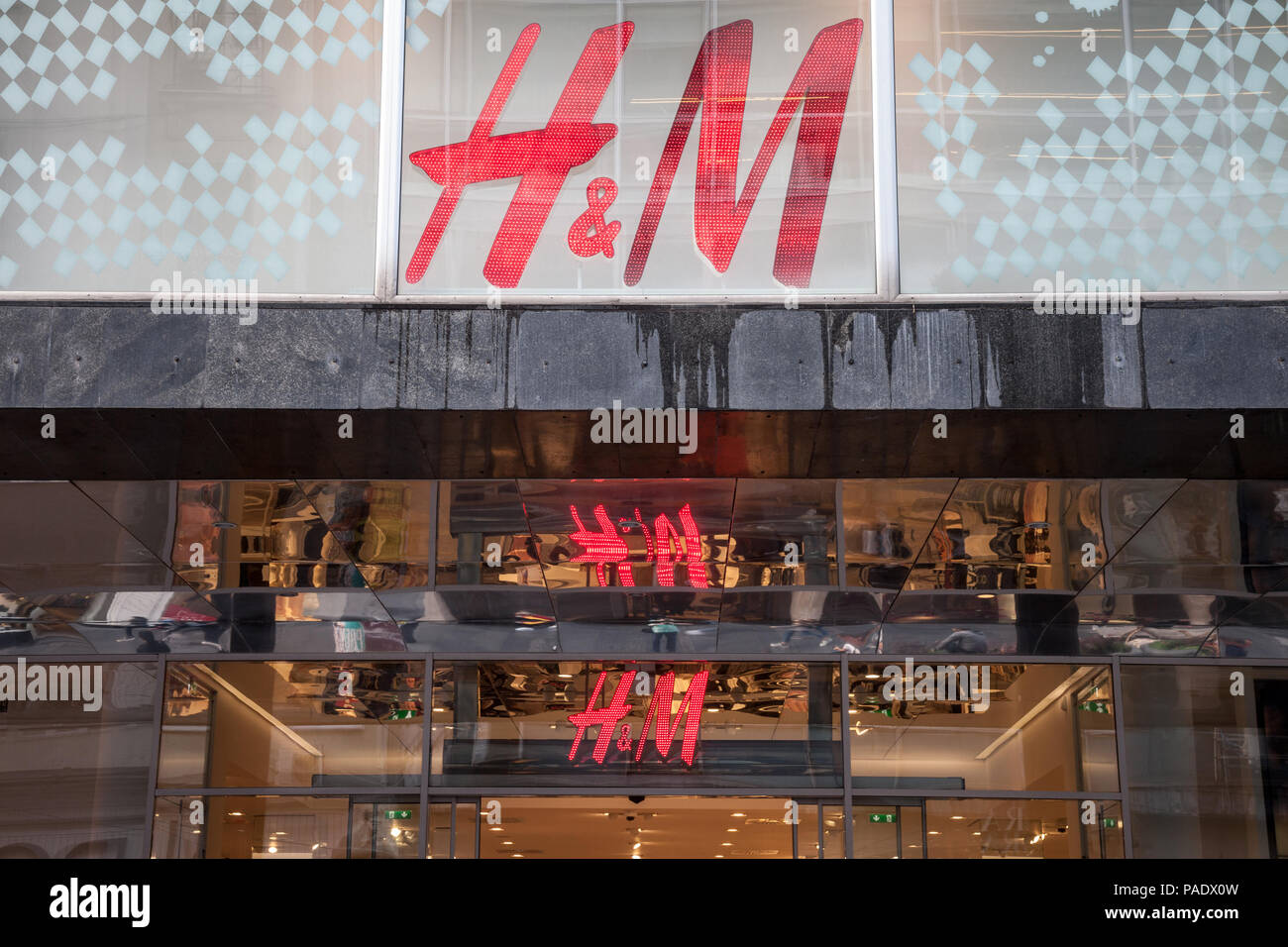 BELGRADE, SERBIA - JULY 9, 2018: Logo of H&M reflecting on the ceiling of their main shop in Belgrade, above the main entrance. H&M is one of the bigg - Stock Image