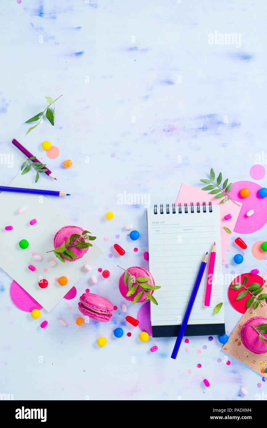 party flat lay with confetti to do list with stationery candies