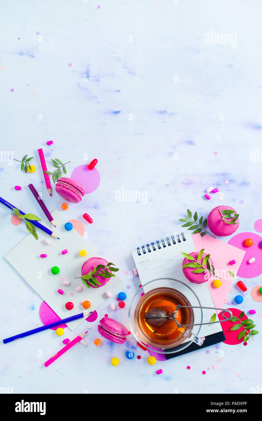 planning a party concept notepad with to do list sweets confetti