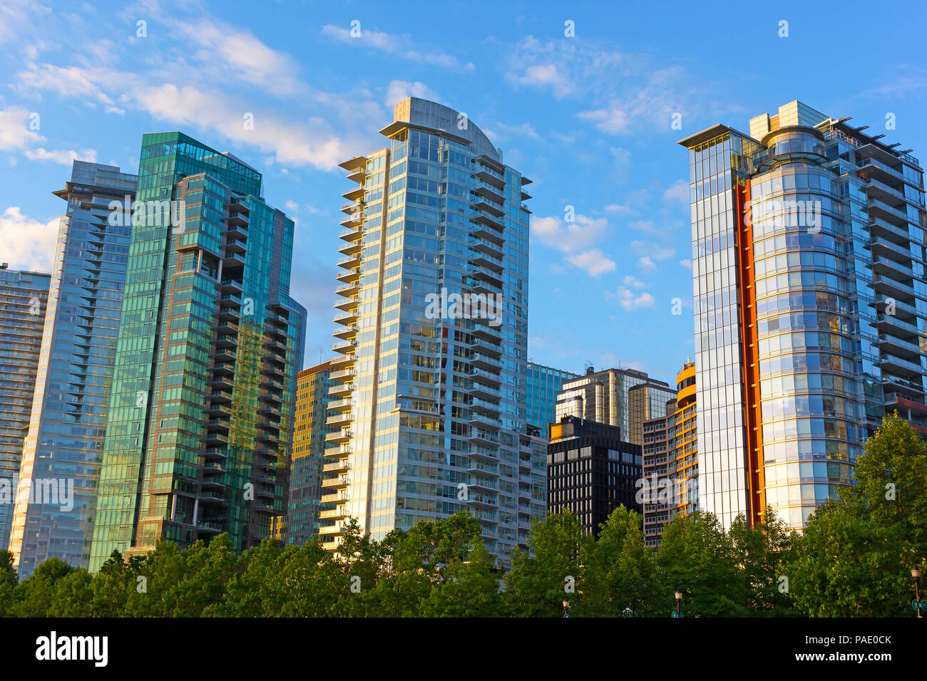 Vancouver downtown panorama at sunrise in summer. Modern buildings architecture near harbor waterfront in Vancouver BC, Canada. - Stock Image
