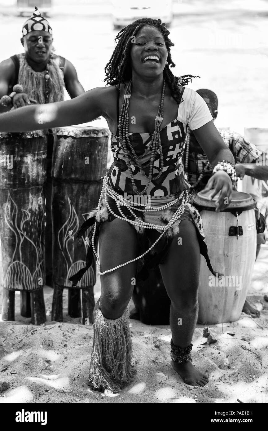 ANGOLA, LUANDA - MARCH 4, 2013:  Angolan beautiful woman dances the national falk dance in black and white in Angola, Mar 4, 2013. Music is one of the - Stock Image
