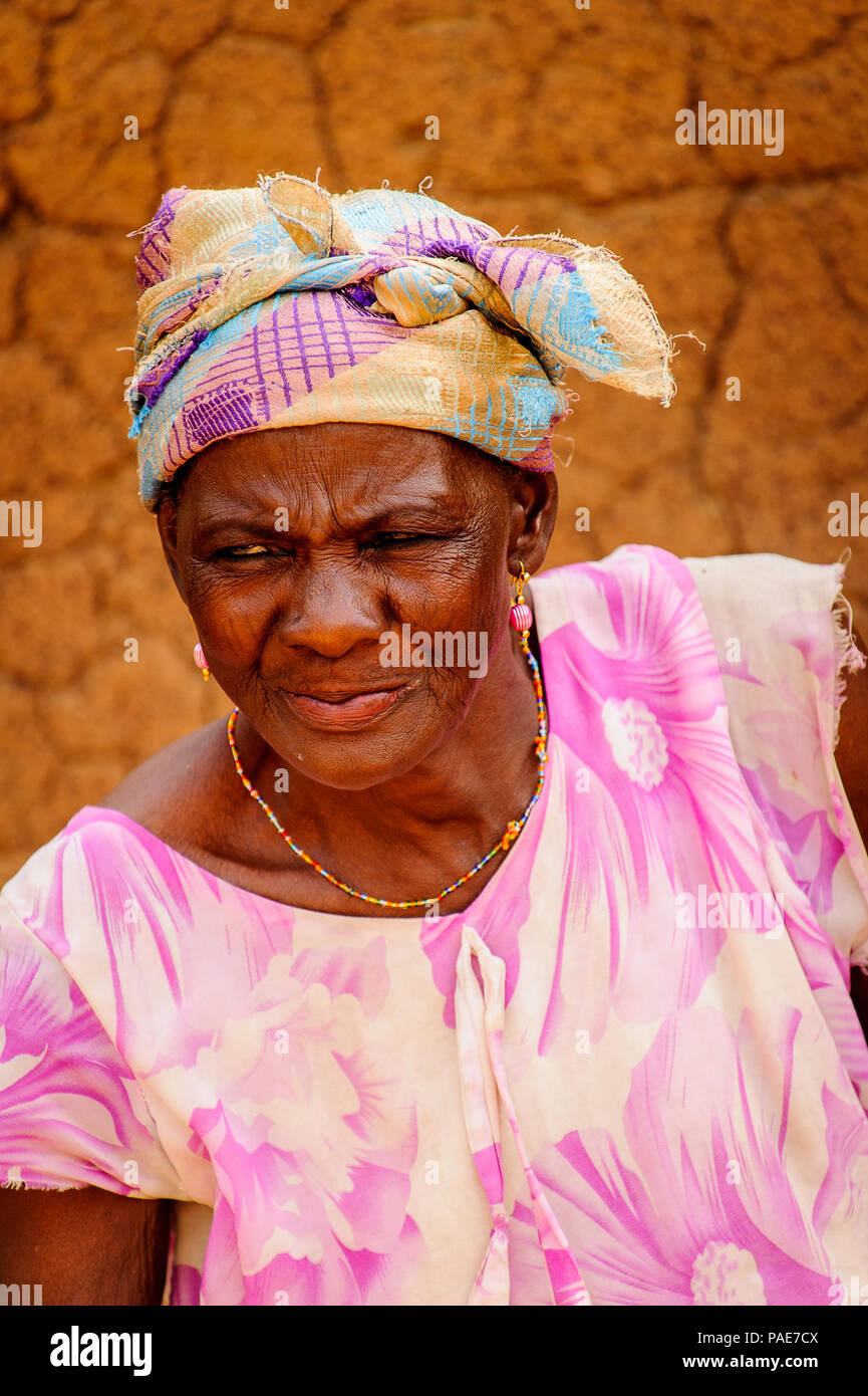 ACCRA, GHANA - MARCH 6, 2012: Unidentified Ghanaian lady in the street in Ghana. People of Ghana suffer of poverty due to the unstable economic situat - Stock Image