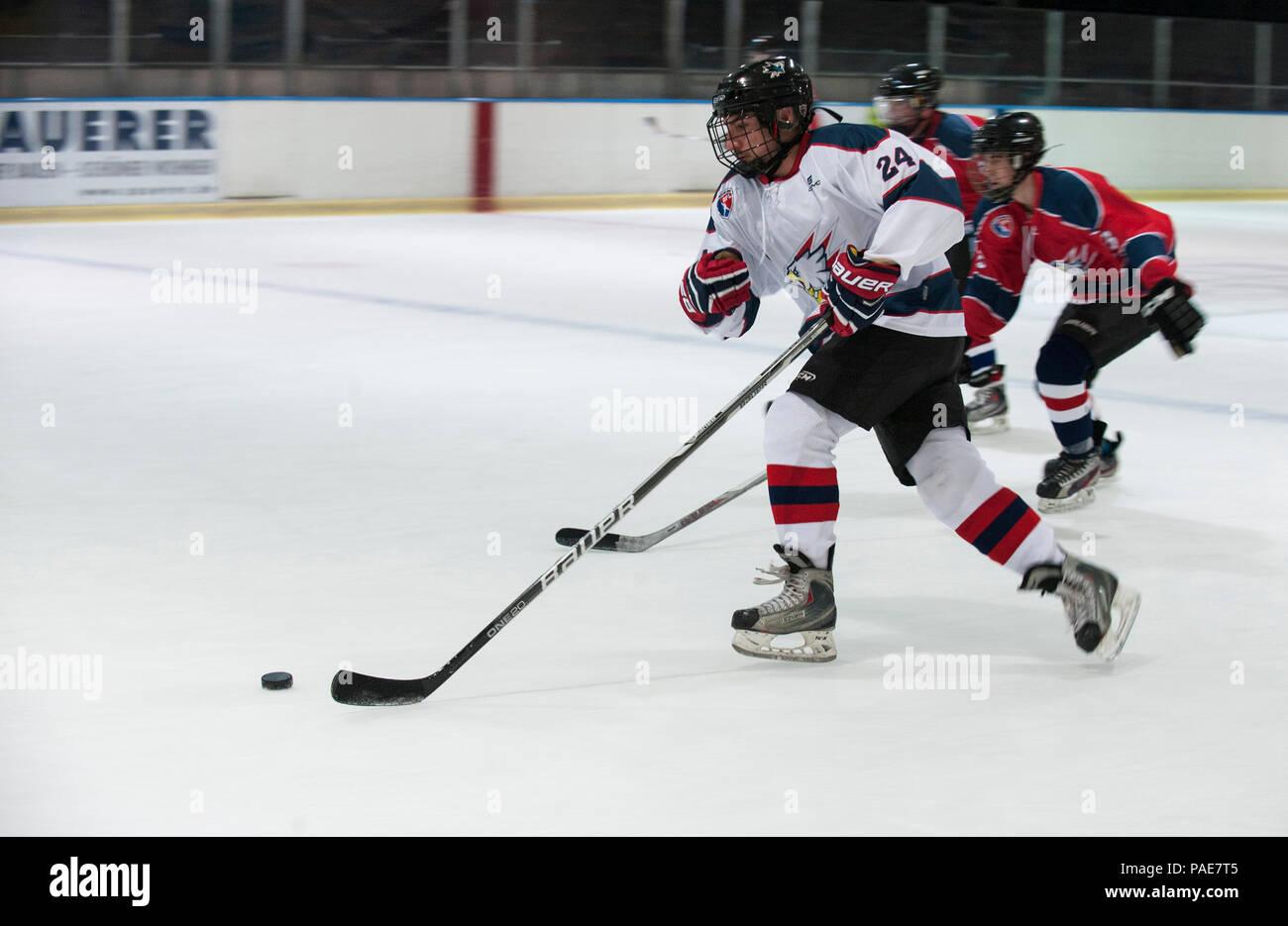 36537beda A member of the Kaiserslautern Military Community Eagles hockey team  maneuvers a hockey puck down the