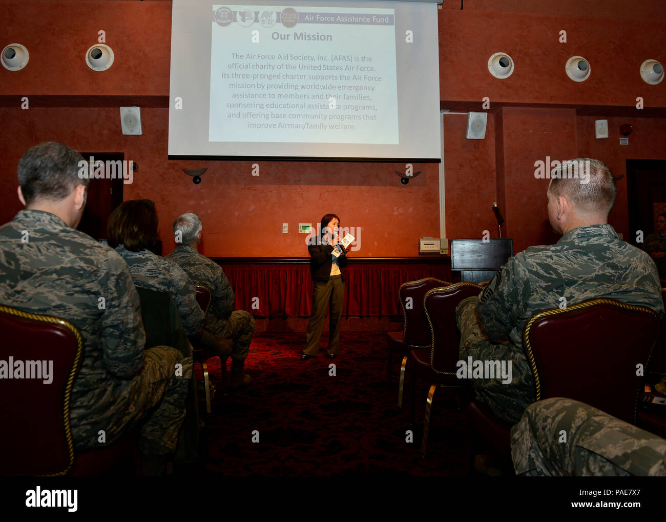 Toni Geronimo, 31st Force Support Squadron community readiness consultant, speaks to attendees at the Air Force Assistance Fund kick-off breakfast, March 18, 2016, at Aviano Air Base, Italy. The AFAF campaign is held from March 21 to April 29, 2016, and helps Airmen and their families in need of financial help. (U.S. Air Force photo by Airman 1st Class Cary Smith/Released) - Stock Image