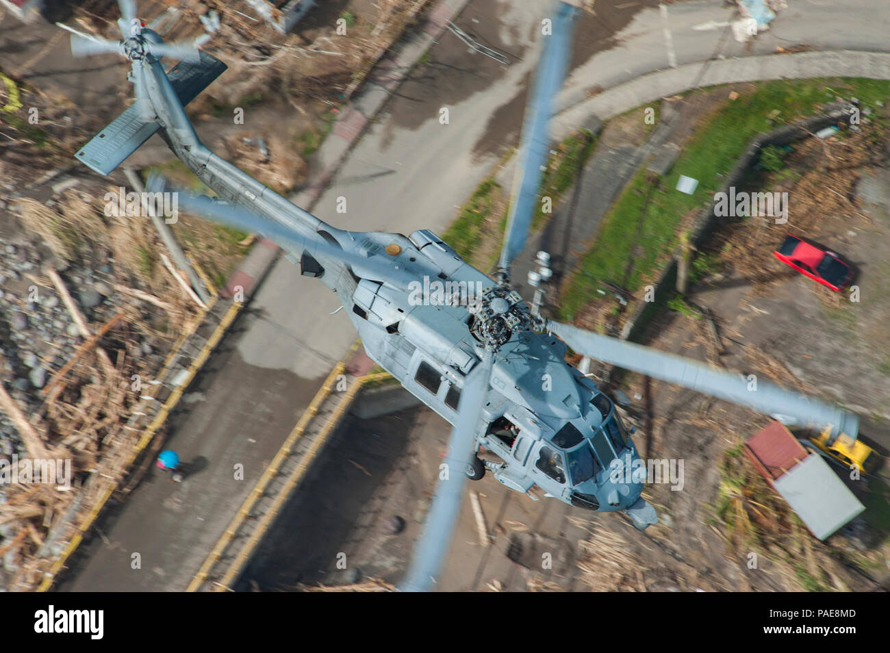 DOMINICA (Sept. 25, 2017) An MH-60S Sea Hawk helicopter  flies over the island of Dominica during U.S. citizen evacuations and humanitarian relief following the landfall of Hurricane Maria. The Department of Defense is supporting the United States Agency for International Development (USAID), the lead federal agency, in helping those affected by Hurricane Maria to minimize suffering and is one component of the overall whole-of-government response effort. - Stock Image