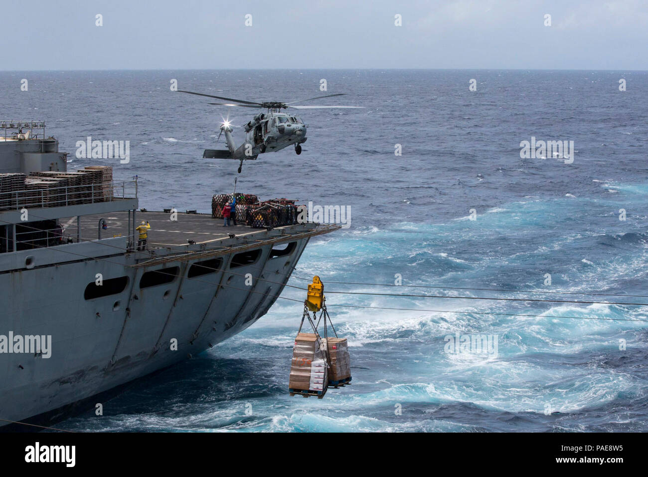 CARIBBEAN SEA (Sept. 28, 2017) Pallets of supplies are transferred from the fast combat support ship USNS Supply (T-AOE 6) to the amphibious assault ship USS Kearsarge (LHD 3) during a replenishment-at-sea for continuing operations in Puerto Rico. Kearsarge is assisting with relief efforts in the aftermath of Hurricane Maria. The Department of Defense is supporting the Federal Emergency Management Agency, the lead federal agency, in helping those affected by Hurricane Maria to minimize suffering and is one component of the overall whole-of-government response effort. - Stock Image