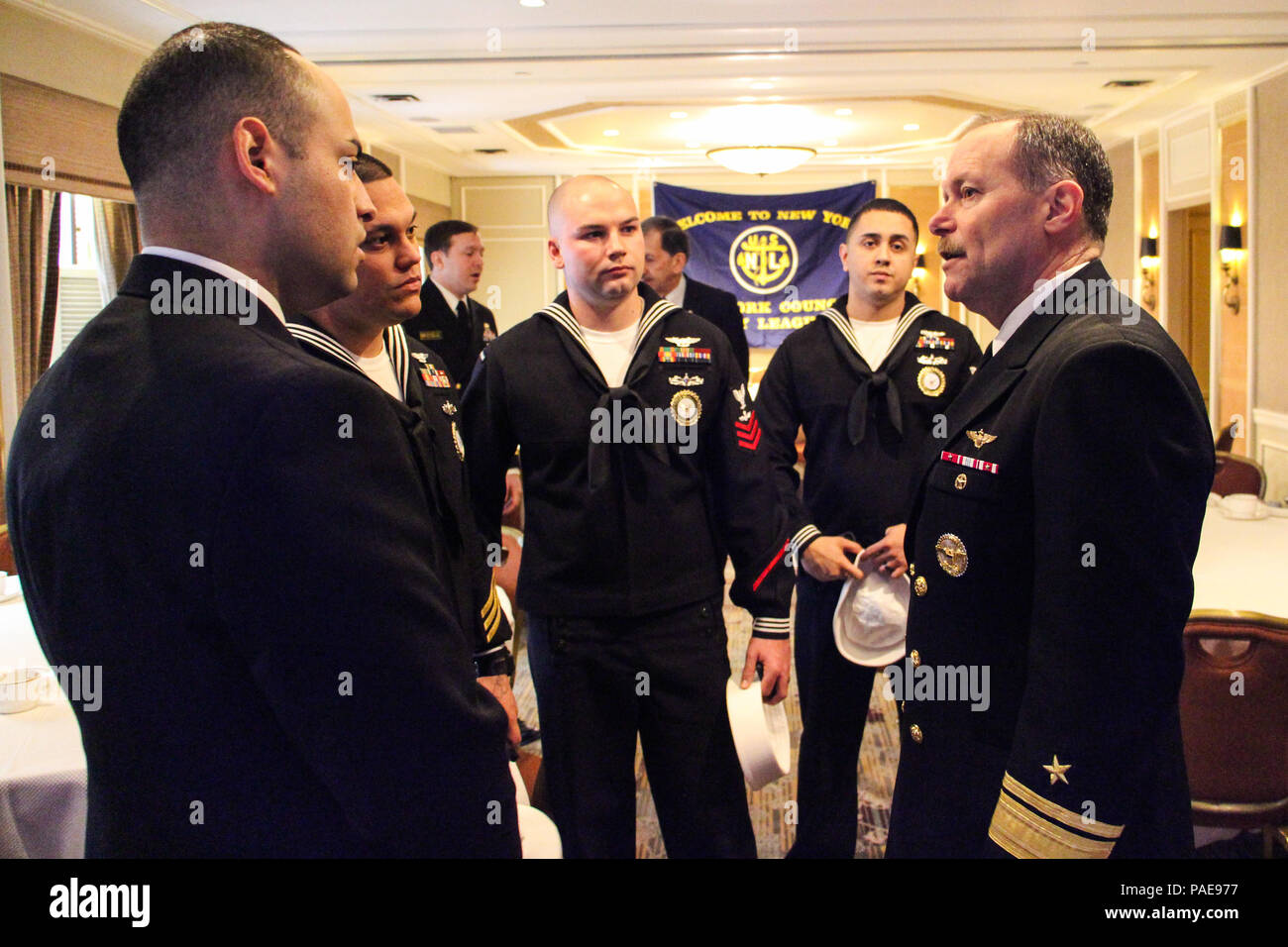 """Rear Adm. Michael C. Manazir, director of air warfare, right, speaks with Sailors assigned to Navy Recruiting District New York at the conclusion of his presentation to members and guests of the New York Council of the Navy League as part of their breakfast speaker series, """"Warfighting in the 21st Century,"""" at the Cornell Club in New York City, March 23. Manazir's presentation and follow on discussion focused on the state of naval aviation, the service's efforts to integrate networks and capabilities across warfighting platforms and how the Navy will meet future challenges. (U.S. Navy photo by Stock Photo"""