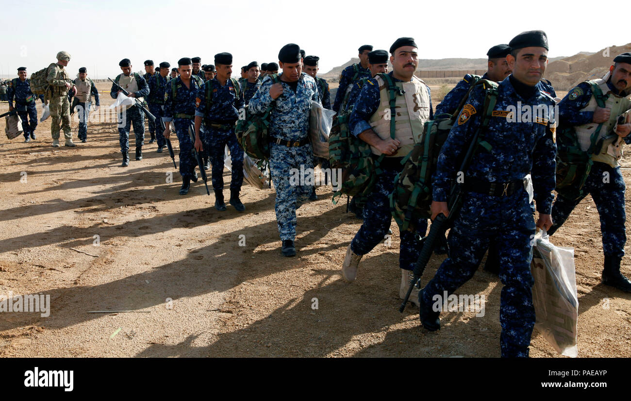 Iraqi Federal Police Force trainees walk with newly issued
