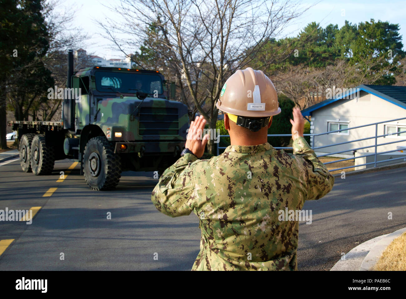 A u. S. Army soldier guides a light medium tactical vehicle as more.