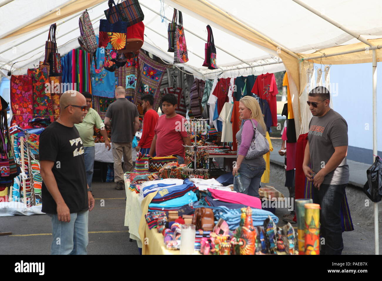 U S  military members look at local items for sale outside