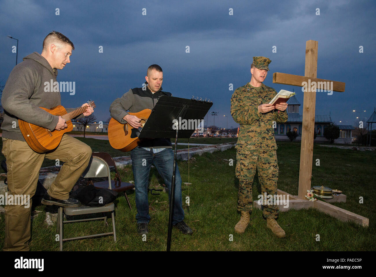 U.S. Service members give praise by song during an Easter sunrise worship service aboard Mihail Kognalniceanu Air Base, Romania, March 27, 2016. Christians around the world celebrated Easter and the resurrection of Jesus Christ. (U.S. Marine Corps photo by Cpl. Kelly L. Street, 2D MARDIV COMCAM/Released) Stock Photo