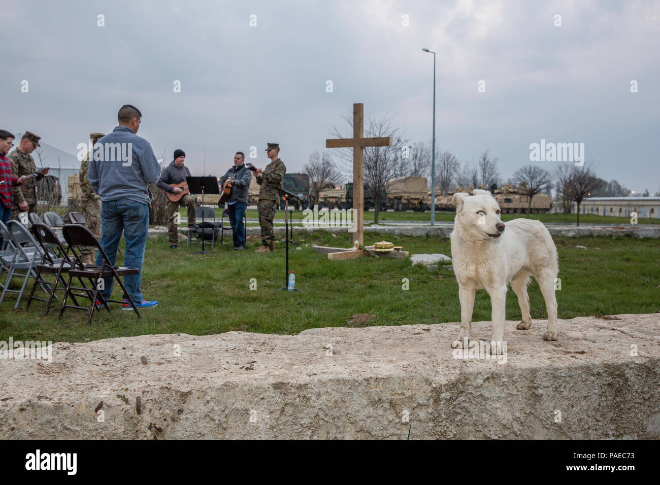 U.S. Service members give praise in song as a stray dog howls in unison during an Easter sunrise worship service aboard Mihail Kognalniceanu Air Base, Romania, March 27, 2016. Christians around the world celebrated Easter and the resurrection of Jesus Christ. (U.S. Marine Corps photo by Cpl. Kelly L. Street, 2D MARDIV COMCAM/Released) Stock Photo