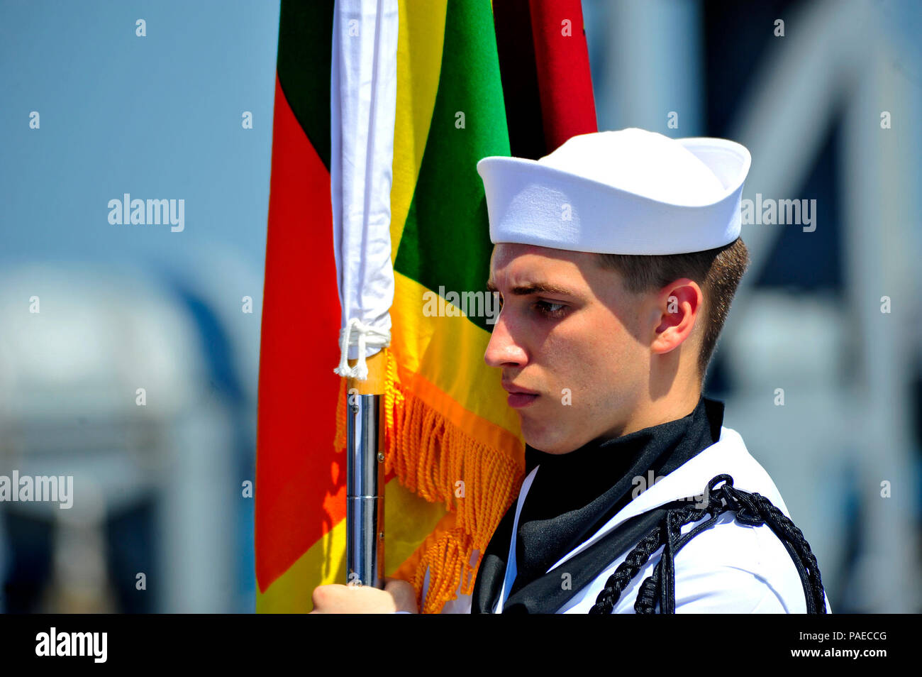 160329-N-YL053-097 COLOMBO, Sri Lanka (March 29, 2016) - Yeoman 3rd Class Daniel Ross, attached to the U.S. 7th Fleet flagship USS Blue Ridge (LCC 19), parades the colors during a change of command ceremony. Capt. Kyle P. Higgins was relieved by Capt. Matthew Paradise in Colombo, Sri Lanka.Blue Ridge is currently on patrol in the 7th Fleet area of operations strengthening and fostering relationships within the Indo-Asia-Pacific. (U.S. Navy photo by Mass Communication Specialist 2nd Class Jacob Waldrop/Released) - Stock Image