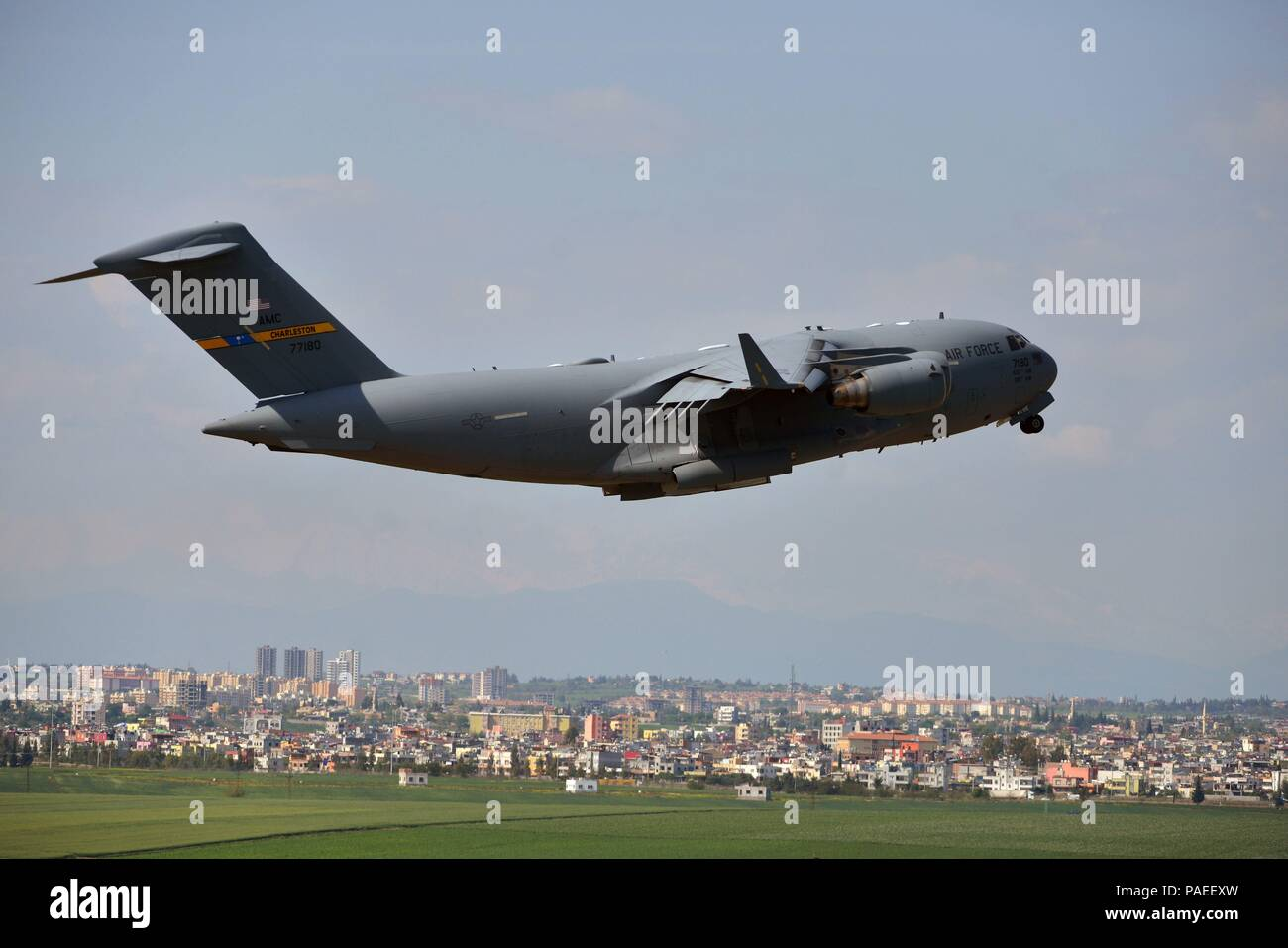 The first C-17 Globemaster III with families of U.S. Airmen and Department of Defense civilians takes off from Incirlik Air Base, Turkey, March 30, 2016. On March 29, 2016, the Secretary of Defense, in coordination with the Secretary of State, ordered the departure of all Department of Defense dependents assigned to Incirlik Air Base. (U.S. Air Force photo by Senior Airman John Nieves Camacho/Released) - Stock Image