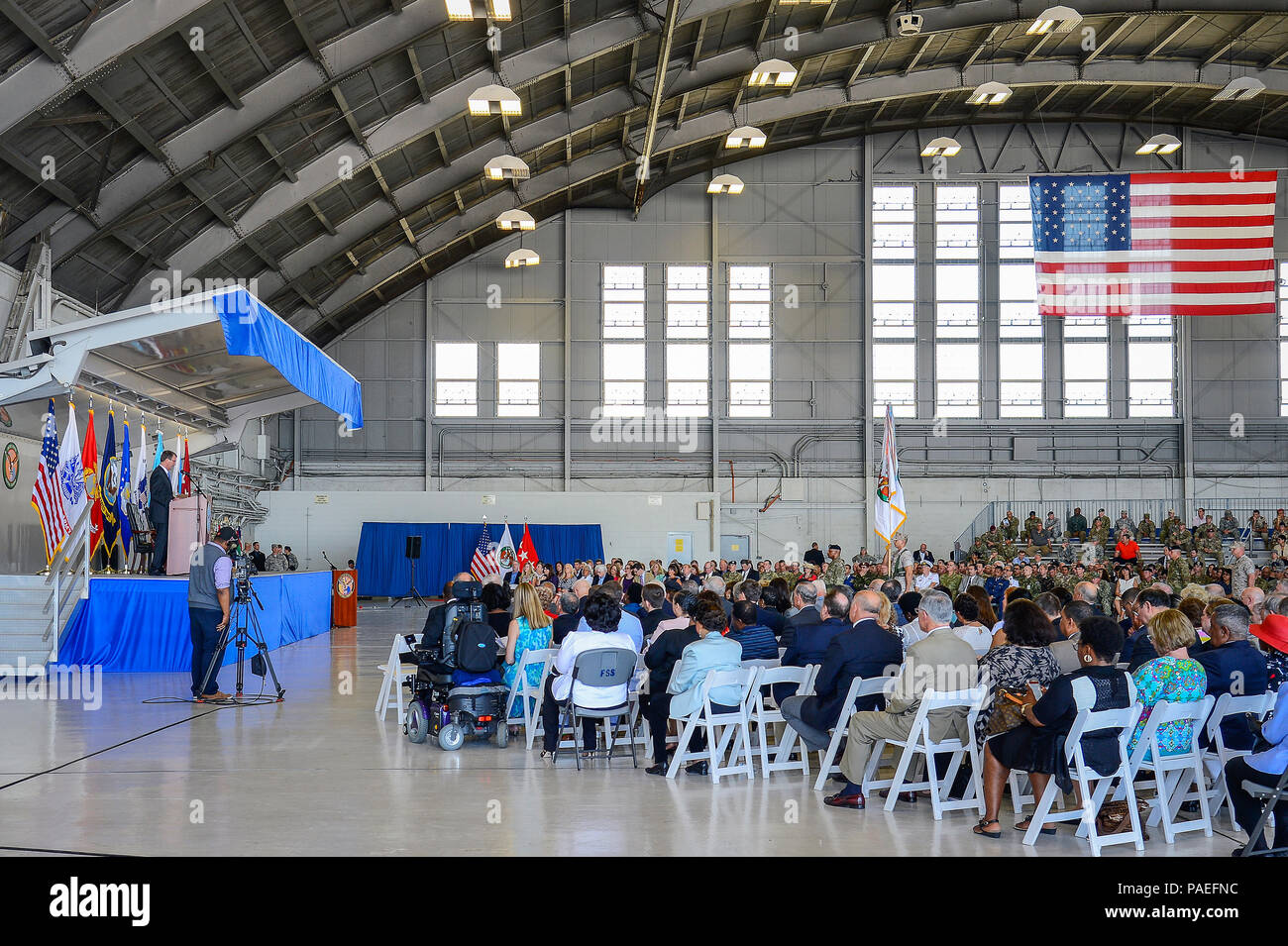 Defense Secretary Ash Carter addresses a crowd at the U.S. Central Command change of command ceremony at MacDill Air Force Base, Fla., March 30, 2016. Secretary Carter officiated the change of command ceremony, which attracted more than 1,000 attendees, including Joint Chiefs of Staff chairman U.S. Marine Gen. Joseph F. Dunford, Central Command's component commanders, community leaders and senior coalition representatives. (U.S. Air Force photo by Senior Airman Ned T. Johnston) Stock Photo