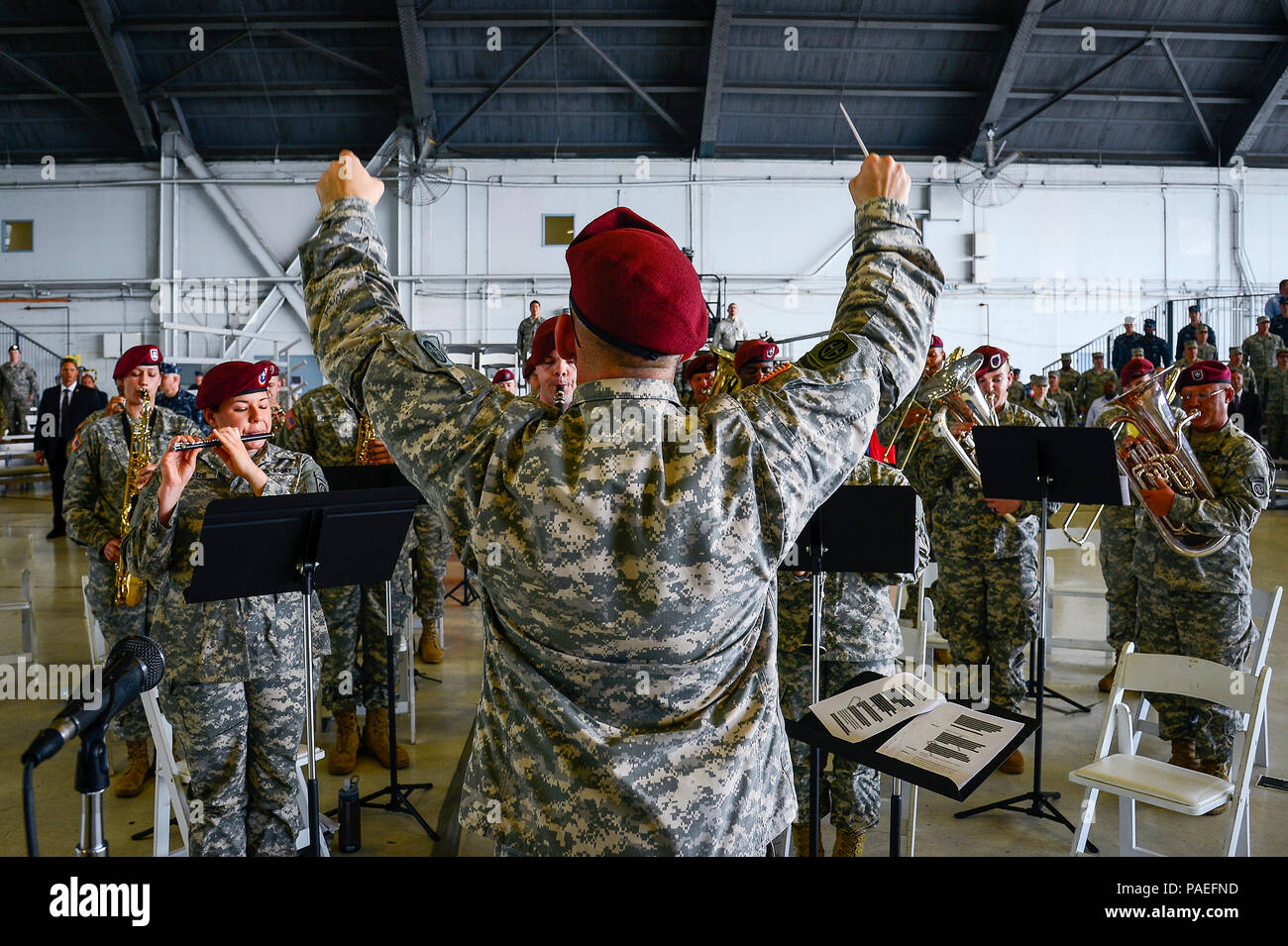 Chief Warrant Officer 3 Russell J. Houser leads the 82nd Airborne Division Band in the Armed Forces Medley at the U.S. Central Command change of command ceremony at MacDill Air Force Base, Fla., March 30, 2016. Defense Secretary Ash Carter officiated the change of command ceremony, which attracted more than 1,000 attendees, including Joint Chiefs of Staff chairman U.S. Marine Gen. Joseph F. Dunford, Central Command's component commanders, community leaders and senior coalition representatives. (U.S. Air Force photo by Senior Airman Ned T. Johnston) Stock Photo