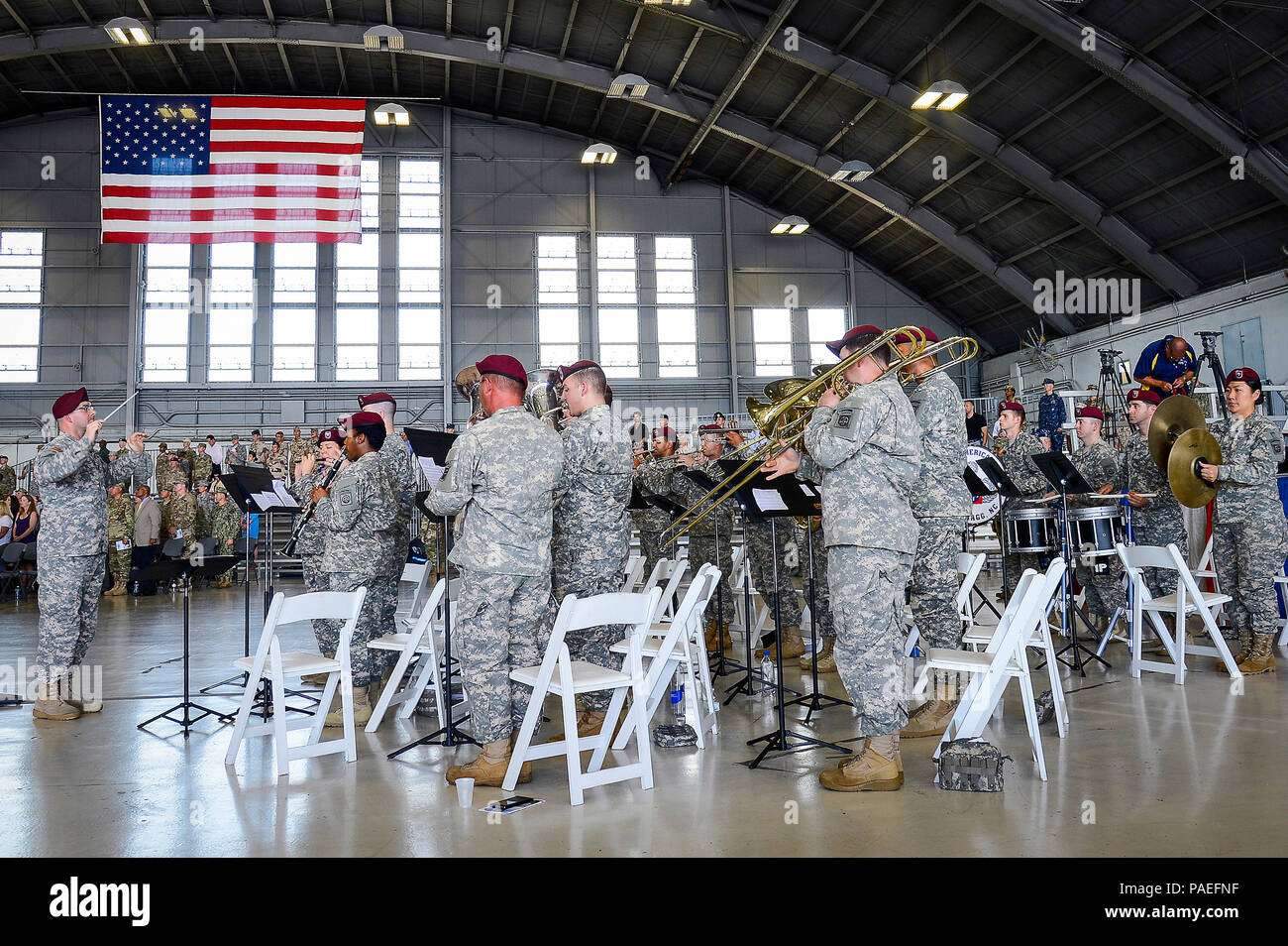The 82nd Airborne Division Band perform the Armed Forces Medley at the U.S. Central Command change of command ceremony at MacDill Air Force Base, Fla., March 30, 2016.  Defense Secretary Ash Carter officiated the change of command ceremony, which attracted more than 1,000 attendees, including Joint Chiefs of Staff chairman U.S. Marine Gen. Joseph F. Dunford, Central Command's component commanders, community leaders and senior coalition representatives. (U.S. Air Force photo by Senior Airman Ned T. Johnston) Stock Photo