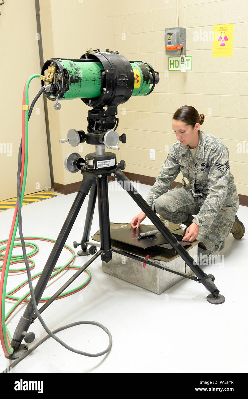 Staff Sgt. Cinnamon Kavlick, assigned to the 388th Equipment Maintenance Squadron, prepares a digital back to scan a weld certification March 25 in their Nondestructive Inspection laboratory at Hill Air Force Base, Utah. The 388th EMS NDI lab recently upgraded its radiography equipment with digital capabilities, which will save time and money while creating a healthier work environment and eliminating hazardous wastes. (U.S. Air Force photo by Todd Cromar) - Stock Image