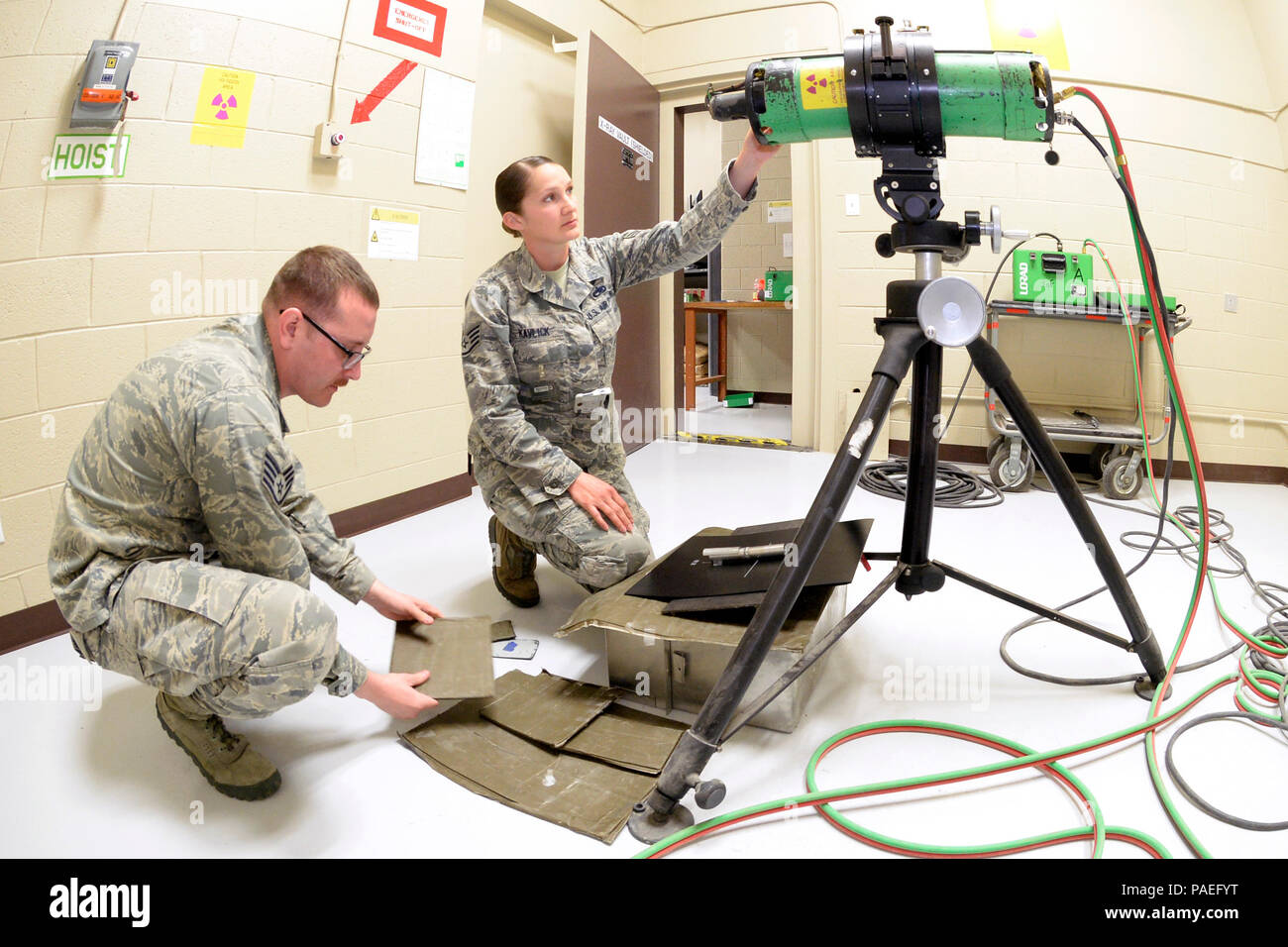 Staff Sgts. Joshua Batman and Cinnamon Kavlick, both assigned to the 388th Equipment Maintenance Squadron, prepare a tube head, lead screens, and digital back to scan a weld certification March 25 in their Nondestructive Inspection laboratory at Hill Air Force Base, Utah. The 388th EMS NDI lab recently upgraded its radiography equipment with digital capabilities, which will save time and money while creating a healthier work environment and eliminating hazardous wastes. (U.S. Air Force photo by Todd Cromar) - Stock Image