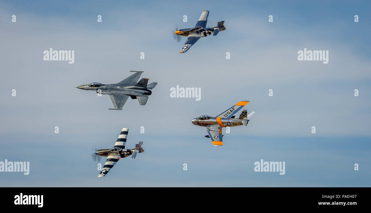 """Three generations  of U.S. Army Air Corps / U.S. Air Force air superiority, and the technological leaps that maintained it, are represented by a single formation of an F-86 """"Sabre"""", F-16 """"Fighting Falcon"""" and two P-51 """"Mustangs"""" during the Heritage Flight Training Course at Davis-Monthan AFB, Tucson, Ariz., Mar 5, 2016. (U.S. Air Force photo by Tech. Sgt. Brandon Shapiro) Stock Photo"""