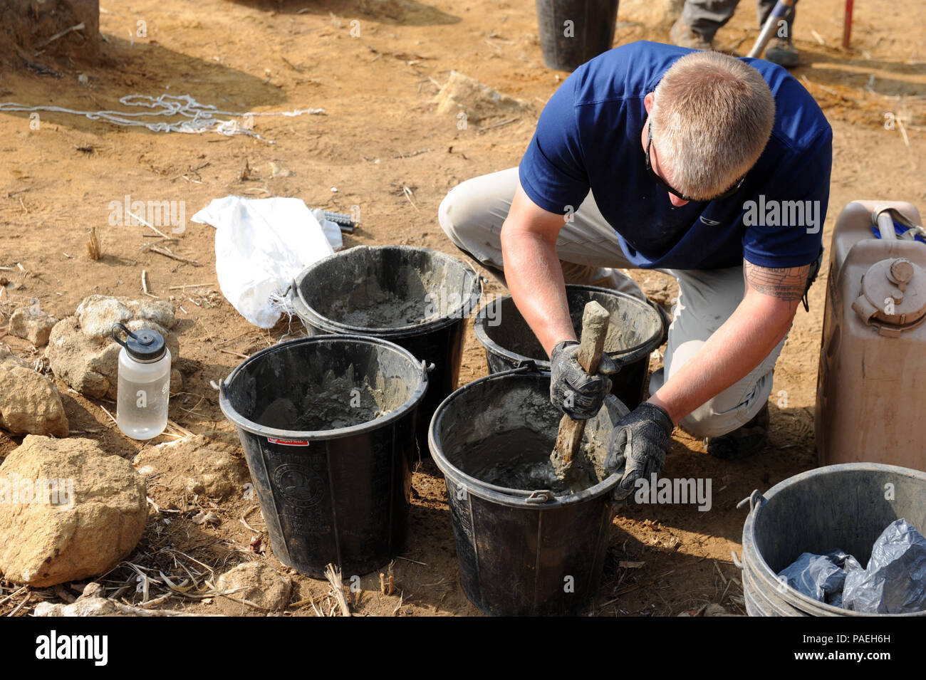 U.S. Army Sgt. 1st Class Patrick Adams, team sergeant with the Defense POW/MIA Accounting Agency (DPAA) mixes cement for a site DATUM in Xiangkhoang Province, Lao People's Democratic Republic, Mar. 31, 2016. Members of the DPAA deployed to the area in hopes of recovering the remains of a pilot unaccounted for during the Vietnam War era. The mission of the DPAA is to provide the fullest possible accounting for our missing personnel to their families and the nation. (DoD photo by Staff Sgt. Jocelyn Ford, USAF/RELEASED) - Stock Image