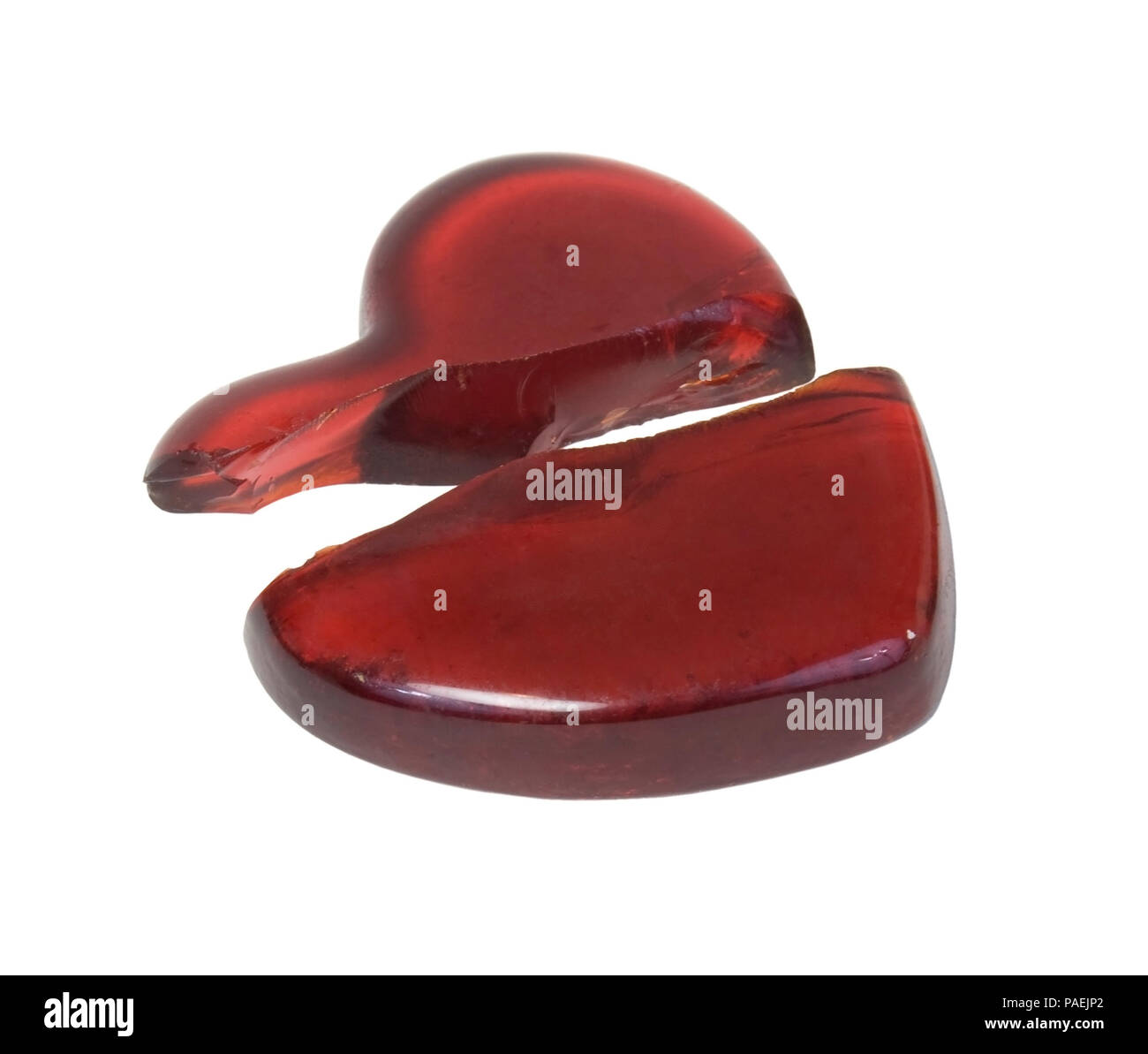 Broken Red glass heart symbolizing a broken heart over a failed romance - path included - Stock Image