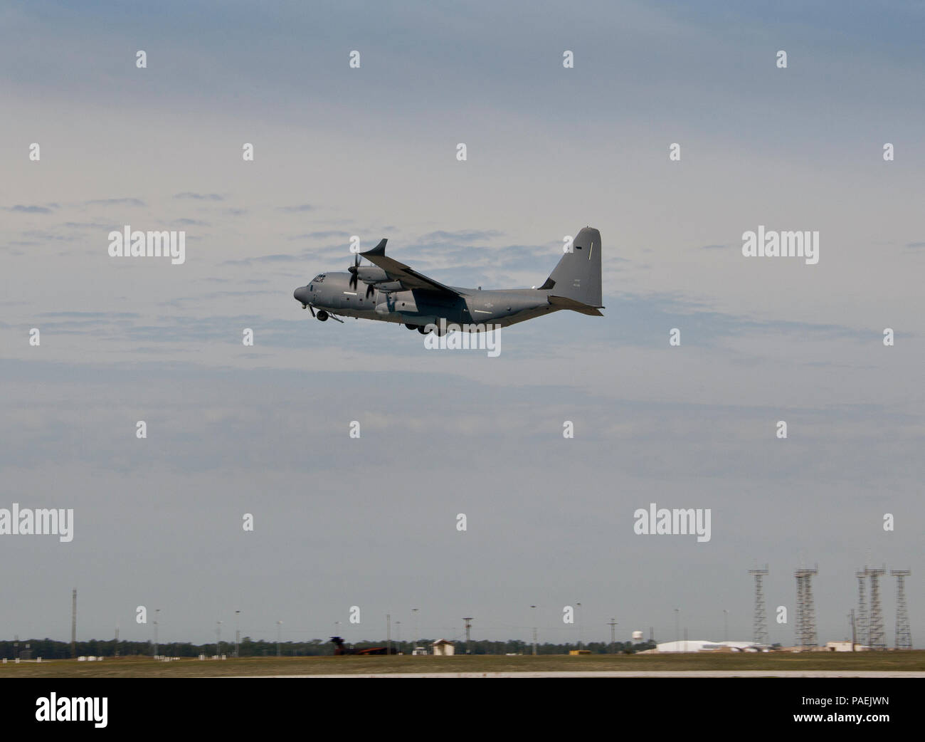A modified MC-130J lifts off from Eglin Air Force Base, Fla., for a test mission. The aircraft was fitted with vertical fins on each wing, called winglets.  The 413th Flight Test Squadron aircrew and engineers tested the modified aircraft over eight flights.  The goal of the tests was to collect data on possible fuel efficiency improvements and performance with the winglets and lift distribution control system installed.  (U.S. Air Force photo/Samuel King Jr.) - Stock Image