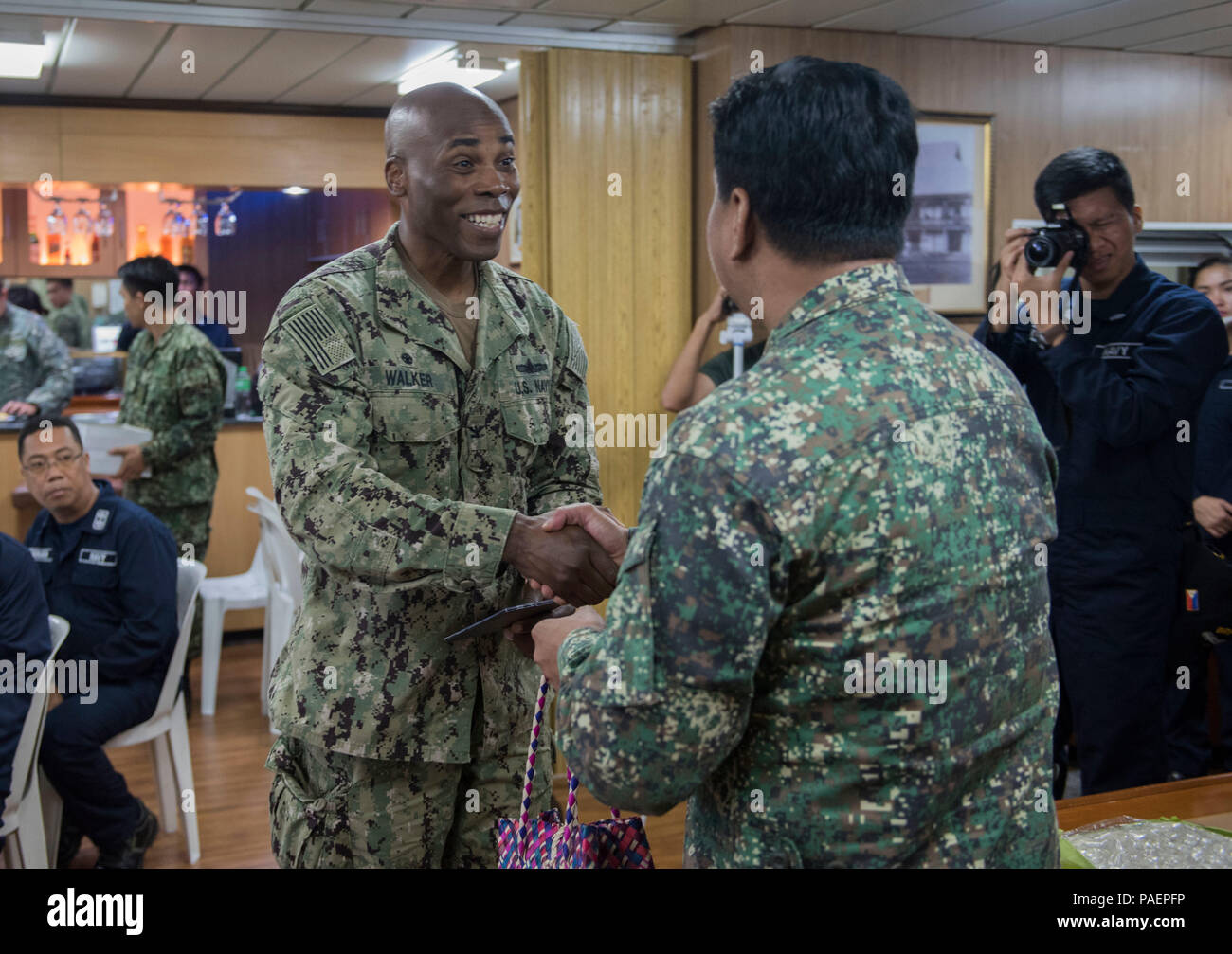 180714-N-OU129-180 SAN FERNANDO CITY, Philippines (July 14, 2018) Capt. Lex Walker, Commodore, Destroyer Squadron 7, exchanges gifts with Philippine Navy Commodore Nichols Driz, Commander, Naval Forces Northern Luzon, at the closing ceremony of Maritime Training Activity (MTA) Sama Sama 2018 aboard Philippine Navy ship BRP Tarlac (LD-601). The week-long engagement focuses on the full spectrum of naval capabilities and is designed to strengthen the close partnership between both navies while cooperatively ensuring maritime security, stability and prosperity. (U.S. Navy photo by Mass Communicati Stock Photo